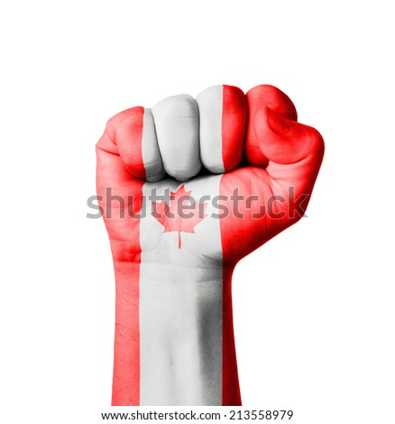 Fist of Canada flag painted - stock photo