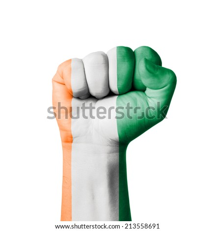 Fist of Ivory Coast flag painted - stock photo