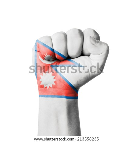 Fist of Nepal flag painted - stock photo