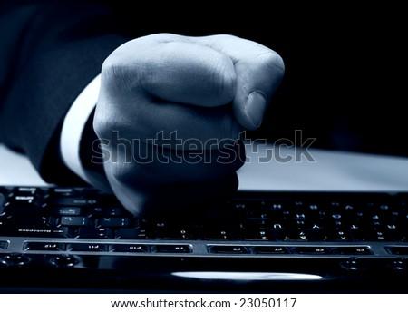 fist on keyboard - stock photo