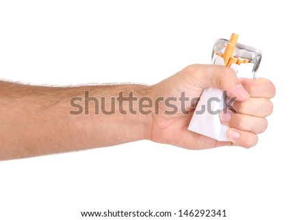 Fist with crushed pack of cigarettes, isolated on white