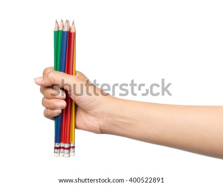 Fist with group of pencils isolated on white background - stock photo
