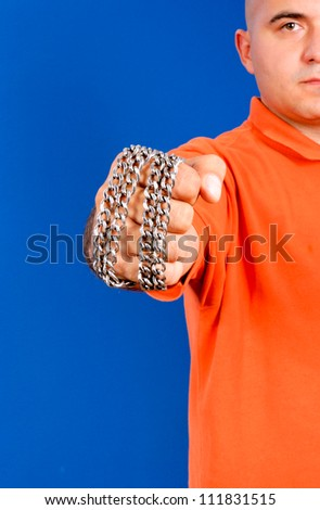 Fist with the metal chail - stock photo