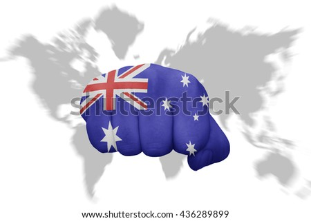 fist with the national flag of australia on a world map background - stock photo