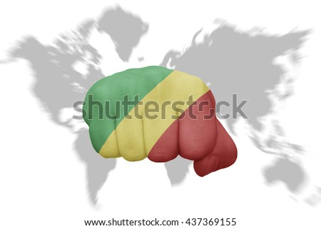 fist with the national flag of republic of the congo on a world map background