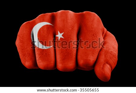 fist with turkish flag isolated on black
