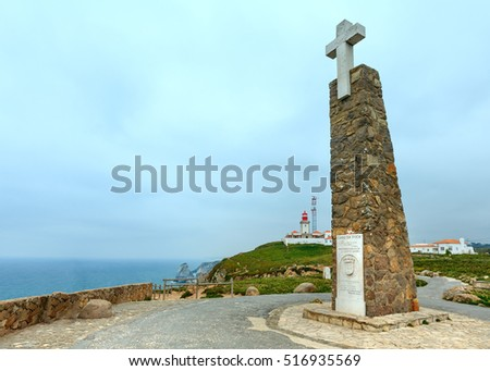 FISTERRA, PORTUGAL -  MAY 14, 2016: Monument declaring Cabo da Roca as the westernmost extent of continental Europe and Lighthouse. Portugal.