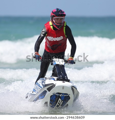 Fistral Beach, Newquay, Cornwall, UK. 6th June, 2015. Professional jet ski riders compete at the IFWA World Tour Jet Ski Championship. Contestants perform numerous tricks for judges in the waves. - stock photo