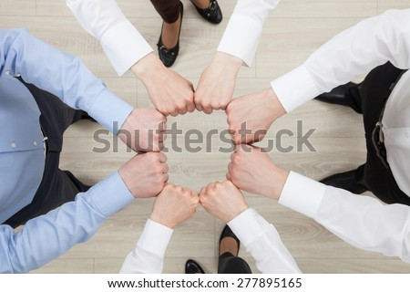 Fists group of businesspeople, view from above - stock photo