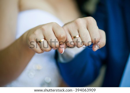Newly wed couples hands wedding rings stock photo 251860945 fists of the newly married couple with wedding rings in them junglespirit Images