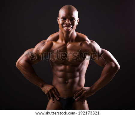 fit african bodybuilder on black background - stock photo