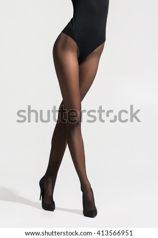Fit and beautiful legs in sexy pantyhose   - stock photo