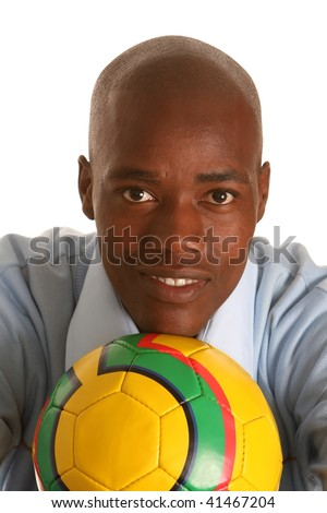 Fit and handsome young African man resting his chin on a soccer ball