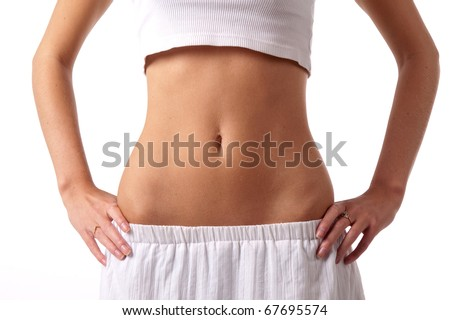 Fit and slim female model exposing her belly and waist - stock photo