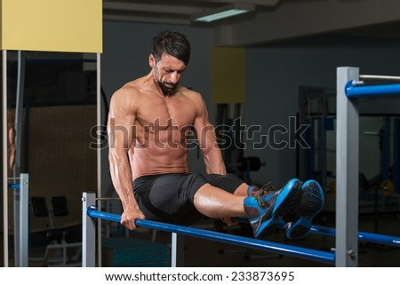 Fit Athlete Working Out Exercise On Parallel Bars