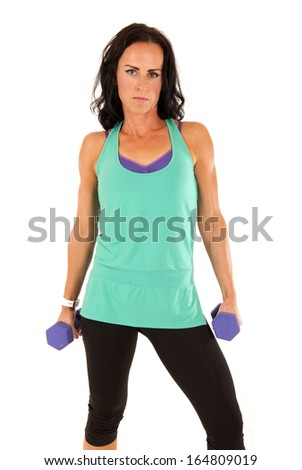 fit attractive brunette woman standing holding barbells