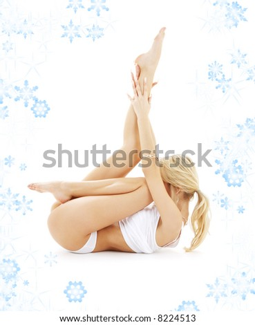 fit blond in white underwear practicing yoga with snowflakes - stock photo