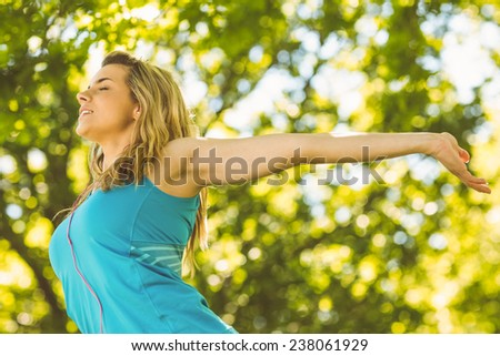 Fit blonde enjoying the sunshine on a sunny day - stock photo