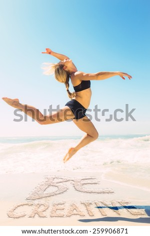 Fit blonde jumping gracefully on the beach against be creative - stock photo