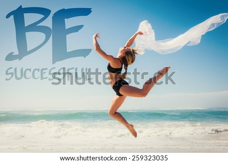 Fit blonde jumping gracefully with scarf on the beach against be sucessful - stock photo