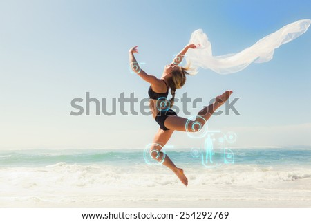 Fit blonde jumping gracefully with scarf on the beach against fitness interface - stock photo