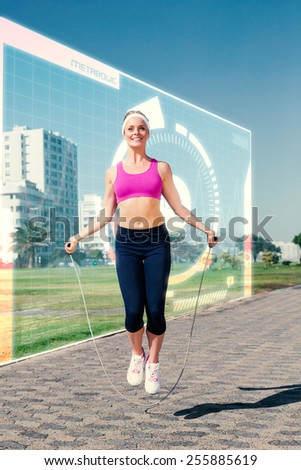 Fit blonde skipping rope on the pier against fitness interface - stock photo