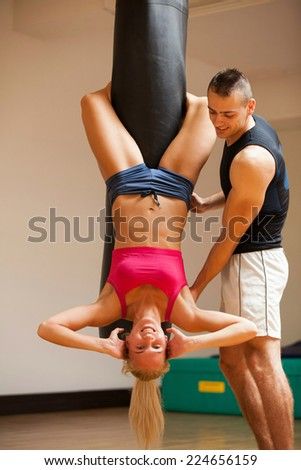 Fit brunette doing sit ups in fitness studio at the gym - stock photo