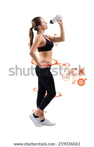 Fit brunette drinking from sports bottle against fitness interface - stock photo