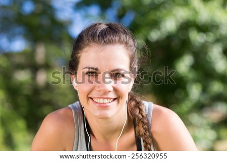 Fit brunette on a run in the park on a sunny day