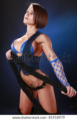 Fit brunette pulls a rope