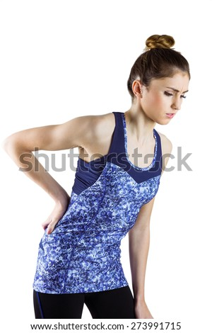 Fit brunette with back injury on white background - stock photo