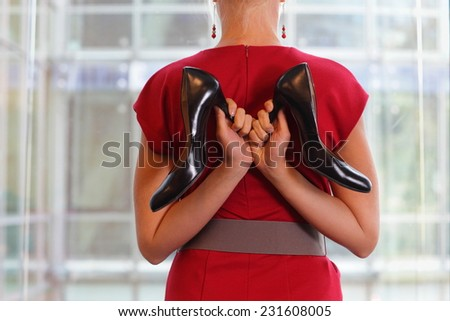 fit business woman in dress with two high heels - stock photo