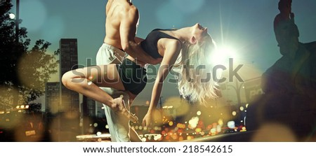Fit couple in the city at night - stock photo