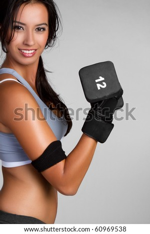 Fit exercising woman lifting weights - stock photo