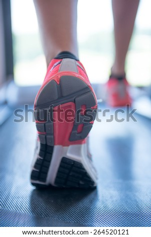 fit female legs on a treadmill at the gym - stock photo