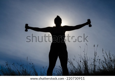 Fit female silhouette holding weights with arms stretched out
