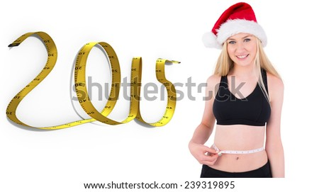 Fit festive young blonde measuring her waist against 2015 tape - stock photo