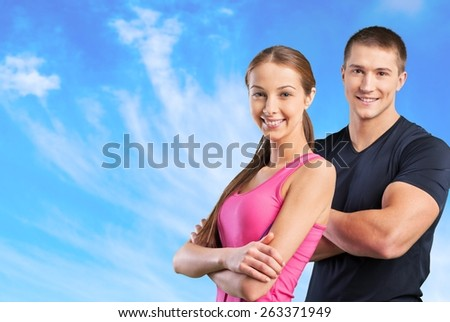 Fit. Fitness instructors posing over white background - stock photo