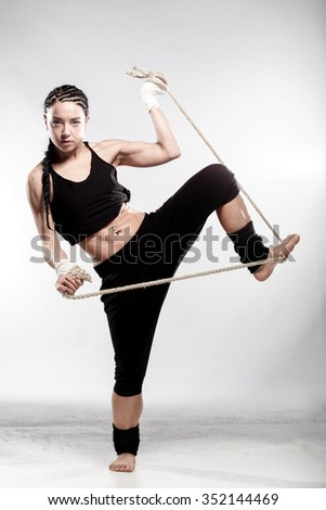 fit girl exercising with a streched rope - stock photo