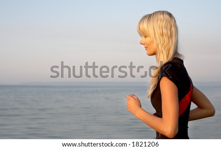 fit girl jogging at the seashore - stock photo