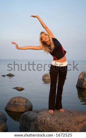 fit girl working out at the seashore - stock photo