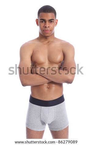 Fit healthy toned body of handsome young African American man wearing grey jockey underwear only, naked upper torso showing off pectoral muscles. - stock photo
