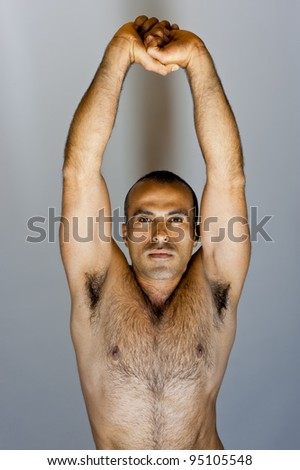 Fit latin guy stretching - stock photo