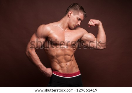 Fit male model showing his biceps - stock photo