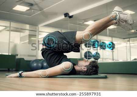 Fit man doing pilates in fitness studio against fitness interface - stock photo
