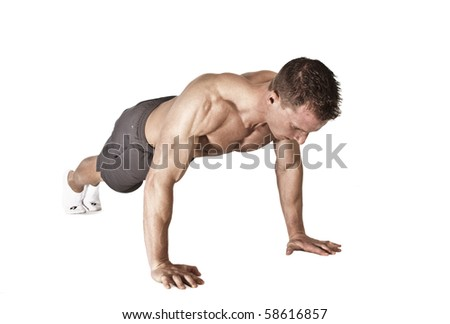 Fit Man doing pushups - stock photo