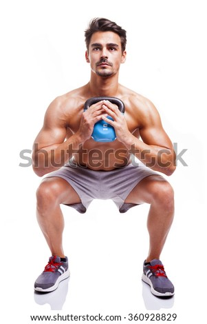 Fit man doing squats, isolated over a white background - stock photo