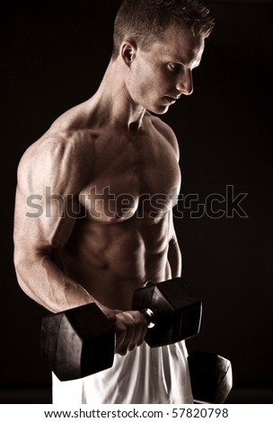 Fit man flexing his muscles - stock photo