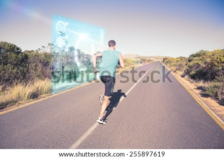 Fit man jogging on the open road against fitness interface - stock photo