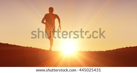 Fit man running against white background against clouds